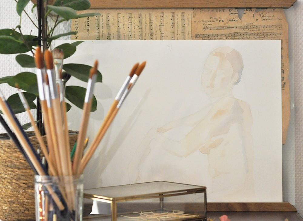 cadre-avec-pinceau-et-aquarelle-de-femme-nue.jpg